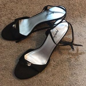 Black heels with diamond over toes